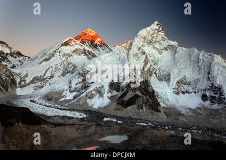 Last light on Mount Everest and Nuptse, seen from Kala Patthar in the Nepal Himalaya - Stock Photo
