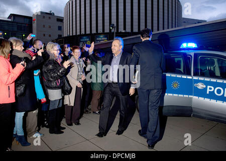 Dresden, Germany. 12th Jan, 2014. German actors Wolfgang Stumph (2-R) is accompanied by police officers as he arrives - Stock Photo