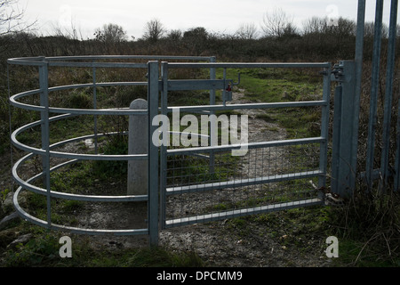 A modern metal swing gate on a footpath in  West Sussex, . Picture by Julie Edwards - Stock Photo
