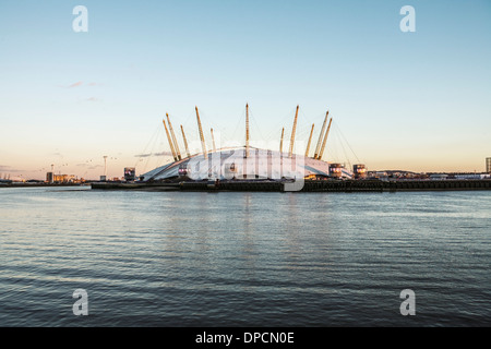 View of the London 02 Arena over the River Thames; and, London's first cable car system in the distance. - Stock Photo