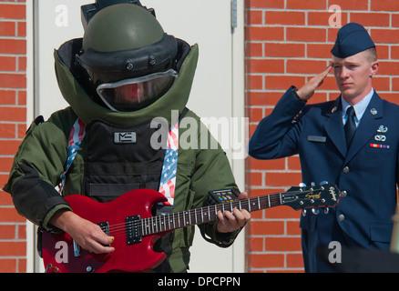 US Air Force Airman 1st Class Eric Johnston an explosive ordnance disposal technician plays the national anthem - Stock Photo