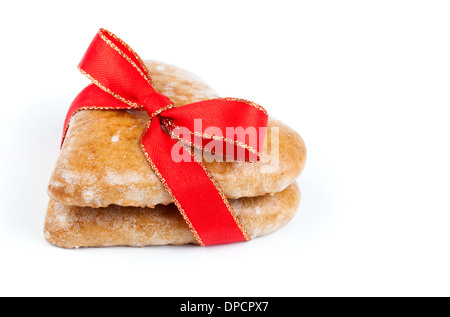 Heart shaped cookie tied with red ribbon on white - Stock Photo