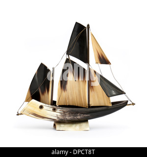 Vintage model sailing ship, handmade from bone or horn - Stock Photo
