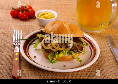 ochsensemmel grilled beef with onion rings in bread rolls close up stock photo royalty free. Black Bedroom Furniture Sets. Home Design Ideas