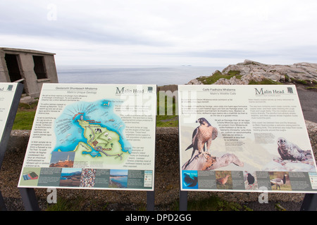 A public sign explains the wildlife and coastal features and cliffs around Malin head on the most westerly point - Stock Photo