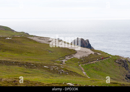 a walking path cuts through coastal features and cliffs around Malin head on the most westerly point of Ireland - Stock Photo