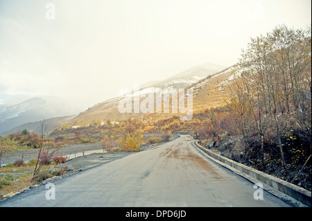 China's Tibet highway snow under the car background - Stock Photo