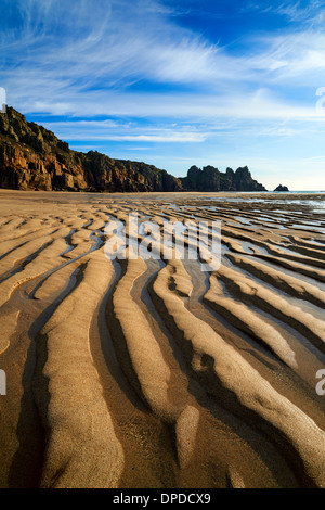 Low tide at Pednvounder beach, large ripples of sand created wave motion - Stock Photo