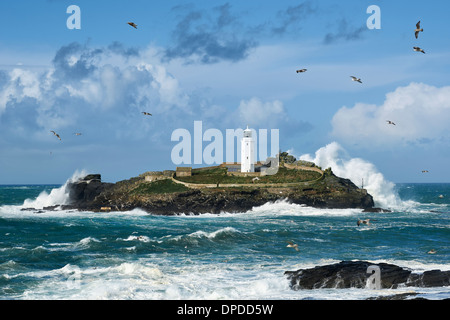 Huge waves hitting Godrevy Island in Cornwall after the storm nicknamed 'St Jude' - Stock Photo
