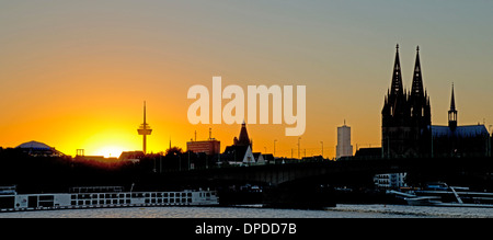 Germany, North Rhine-Westphalia, Cologne, view from Deutz riverside to Cologne Cathedral over Rhine river during - Stock Photo