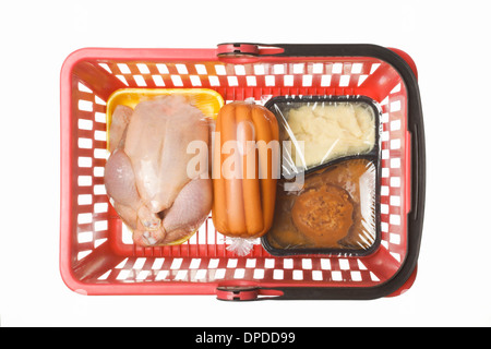 Shopping basket with convenience food, conserved sausages and a chicken in transparent plastic wrapping, studio - Stock Photo