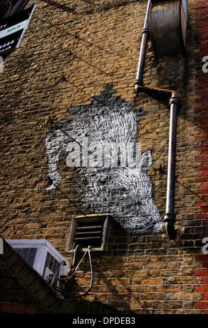 Urban street spray can wall painted art of a giant rat, Brick Lane area, East London E1 UK - Stock Photo