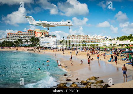 Private jet lands at Maho Beach in Philipsburg, Sint Maarten - Stock Photo
