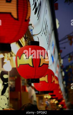 Red paper lanterns in the market at Asakusa near Senso-ji, Tokyo, Japan. - Stock Photo