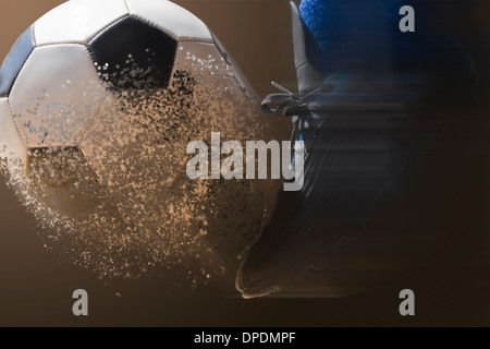 Close up soccer player and football with blurred motion - Stock Photo