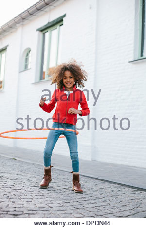 Young girl practicing with hoola hoop - Stock Photo