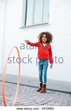 Young girl playing with hoola hoop - Stock Photo