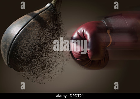 Close up boxer and punch bag with blurred motion - Stock Photo