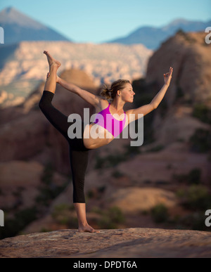 Young woman doing yoga, Moab, Utah, USA - Stock Photo
