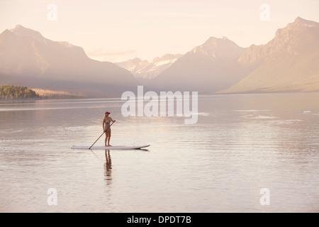 Woman on canoe, Lake McDonald, Glacier National Park, Montana, USA - Stock Photo