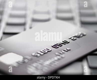 Credit card on laptop to illustrate internet shopping and internet fraud - Stock Photo