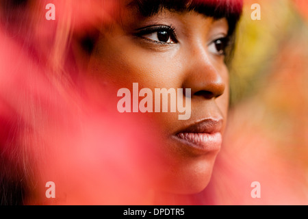 Close up portrait of thoughtful young woman - Stock Photo