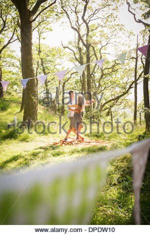 Young couple dancing in forest - Stock Photo