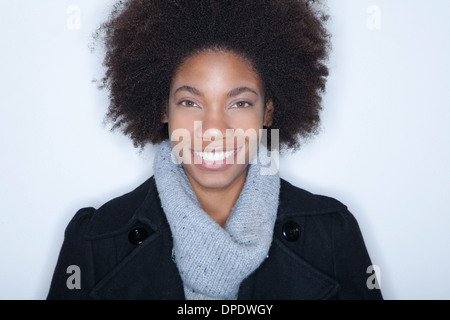 Studio portrait of young woman with afro - Stock Photo