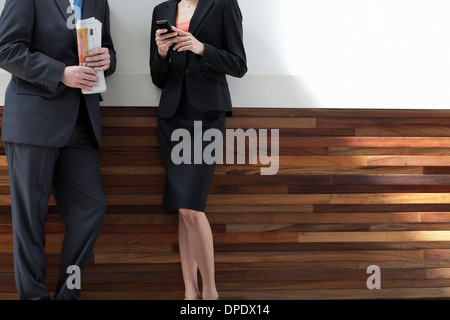 Businesspeople standing together - Stock Photo