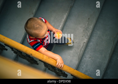 Abstract photo of little boy on the stairs. - Stock Photo