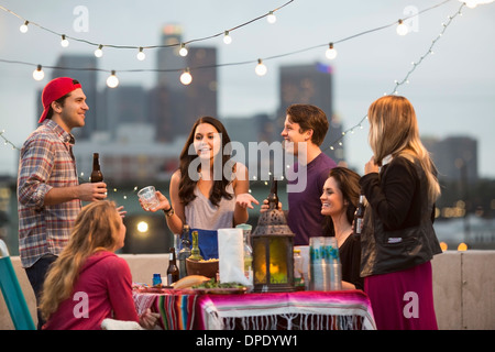 Young adult friends having fun at barbeque - Stock Photo
