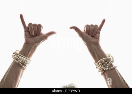 Studio shot of mature woman's gesturing hands - Stock Photo