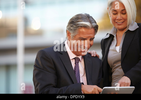 Businesspeople using digital tablet - Stock Photo