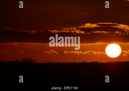 A winter Sunset.. Over some fields in England. Nice warm Oranges Stock Photo