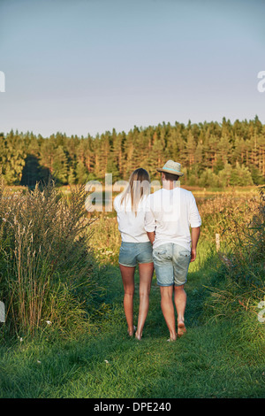Romantic young couple strolling, Gavle, Sweden - Stock Photo