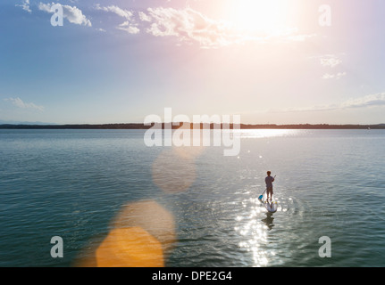 Paddling in Lake Starnberg, Bavaria, Germany - Stock Photo