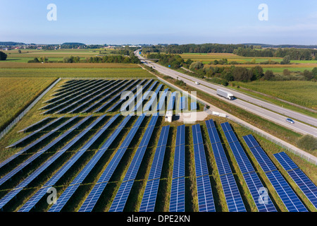 View of road and solar power panels, Munich, Bavaria, Germany - Stock Photo