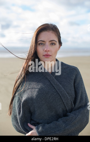 Young woman wearing grey jacket - Stock Photo