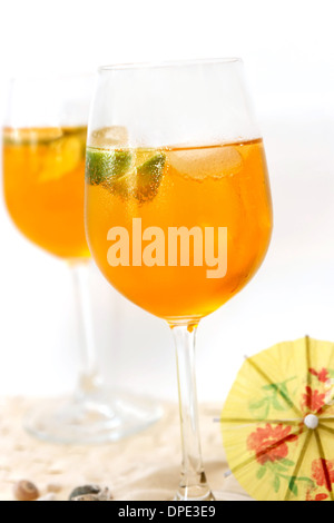 Aperol Spritz in a wine glass with lemon slice - Stock Photo