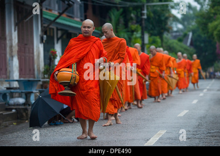 Monks on the morning alms round, Luang Prabang, Laos - Stock Photo