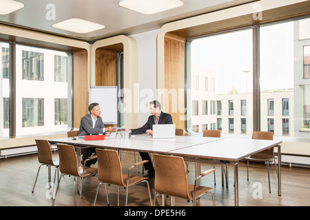 Businessmen meeting in conference room - Stock Photo