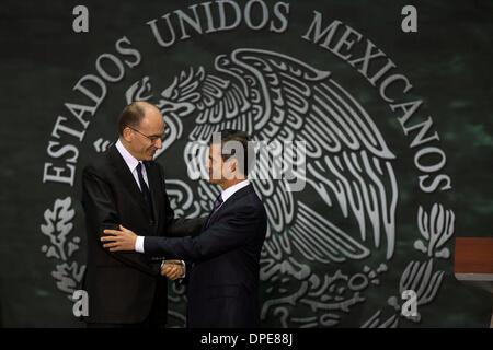 Mexico City, Mexico. 13th Jan, 2014. Mexican President Enrique Pena Nieto (R) shakes hands with Italian Prime Minister - Stock Photo