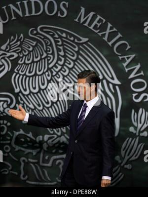 Mexico City, Mexico. 13th Jan, 2014. Mexican President Enrique Pena Nieto reacts during an official reception for - Stock Photo