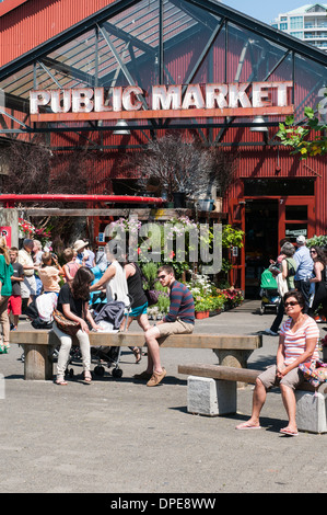 People sitting on benches in front of the entrance to Granville Island public market, Vancouver City,  British Columbia - Stock Photo