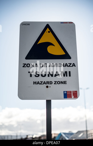 PUNTA ARENAS, Chile - A tsunami wawrning sign in Punta Arenas, Chile. The city is the largest south of the 46th - Stock Photo