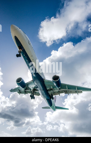 A commercial jet approaches Princess Juliana Airport. - Stock Photo