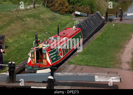 A traditional working narrowboat in Lock 8 of the Audlem flight of locks on the Shropshire Union Canal - Stock Photo