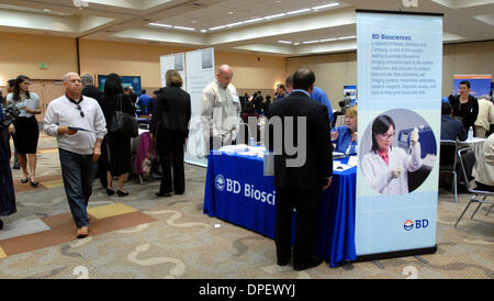 Exhibitors and job seekers meet at a Life Science Career Fair in South San Francisco, Calif., on Monday, March 9, - Stock Photo