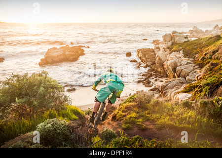 Mountain biker moving down coastal path, Monterey Bay area, California, USA - Stock Photo