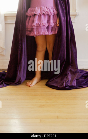 Low section of girl wearing cape costume